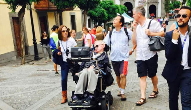 Stephen Hawking being guided around Gran Canaria with Intercruises' Antonio Perez (far right)